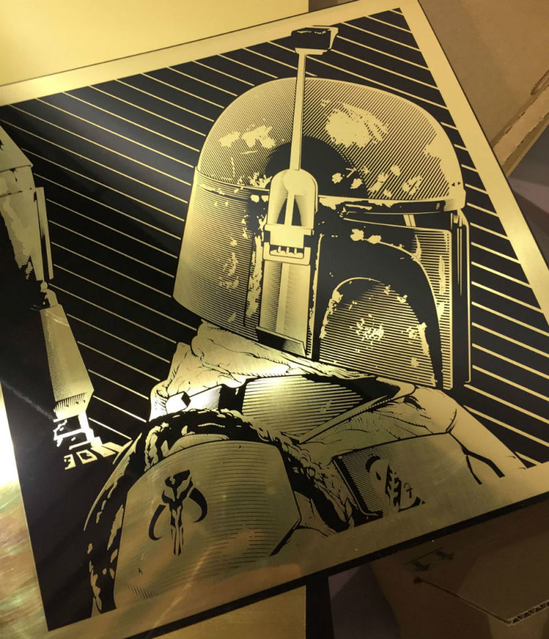 """Boba Fett"" by Joshua Budich.  12"" x 12"" Laser engrave on brass.  Ed of 20 S/N.  $100"